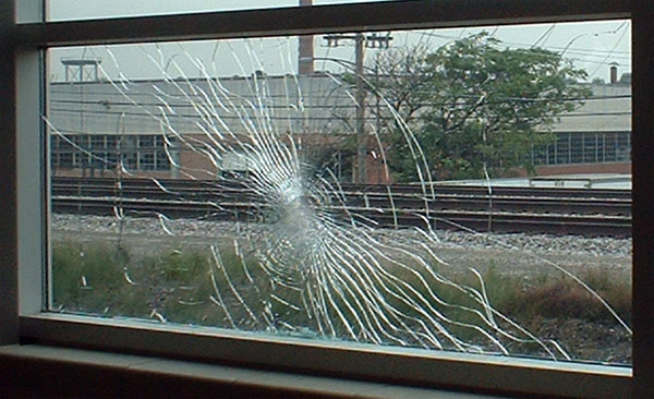 Photo of glass breakage. Vandal with big ideas hurled a sizeable rock and achieved a big breakage pattern, but failed to breach the castle's defenses.