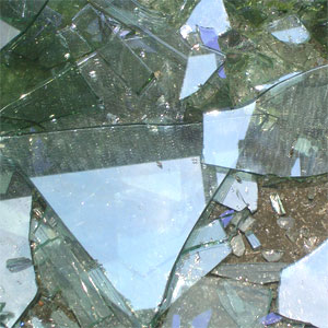 Photo of broken glass. Danger of glass breakage injury. Glass shards from broken annealed or heat strengthened glass are dangerous and must be handled with care.