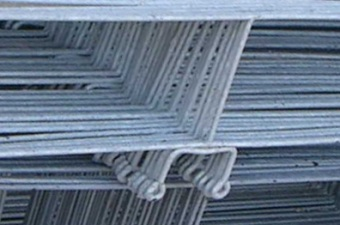 Galvanized wire tiebacks are bedded in mortar joints so that the little loops project out, available for hooks coming from the face brick, to engage.
